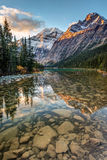Mount Edith Cavell Sunrise. Mount Edith Cavell reflected in the calm river at sunrise in the rocky mountains of Jasper National Park, Alberta, Canada. Another stock photo