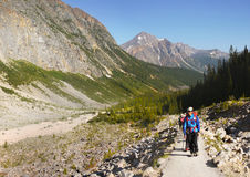 Mount Edith Cavell Trail. Trekkers on Mount Edith Cavell trail, Rocky Mountains, Jasper National Park, Canada stock images