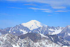Mount Elbrus. View from the top. Visible in the distance snow-capped cone of Mount Elbrus royalty free stock images