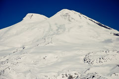 Mount Elbrus. In the sunny winter day. Caucasus. The highest mountain in Europe royalty free stock photo