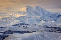 Mount Elbrus in the autumn sun at daybreak. Stock Photo