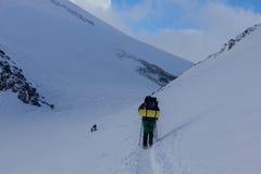 2014 07 Mount Elbrus, Russia: Single man climbs Mount Elbrus Royalty Free Stock Photography