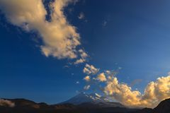 Mount Elbrus during sunset in the rays of the sun. stock photos