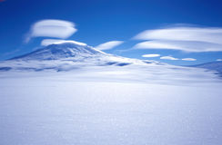 Mount Erebus Clouds. Lenticular clouds over the active volcano Mount Erebus located on Ross Island Antarctica.  The USAP station McMurdo is located on Ross Stock Image