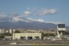 Mount Etna. Catania Airport, in Sicily, seen with Mount Etna in the far distance, behind stock photography