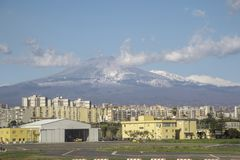 Mount Etna. Catania Airport, in Sicily, seen with Mount Etna in the far distance, behind stock images