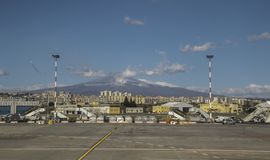 Mount Etna. Catania Airport, in Sicily, seen with Mount Etna in the far distance, behind stock image