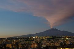 Mount Etna Erupting Over A Sleeping Catania royalty free stock image