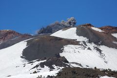 Mount Etna Erupts. In Spring as hikers climb to summit royalty free stock images