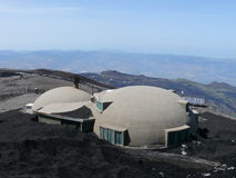 Mount Etna. Old Observatory at Mount Etna volcano covered by black lava, Sicily, Italy royalty free stock image