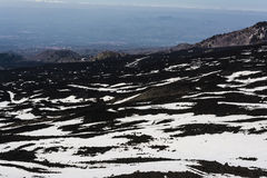 Mount Etna peak with snow and volcanic rocks, Sicily, Italy Royalty Free Stock Image
