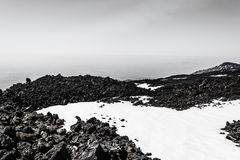 Mount Etna peak with snow and volcanic rocks, Sicily, Italy Royalty Free Stock Images