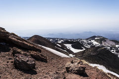 Mount Etna peak with snow and volcanic rocks, Sicily, Italy Stock Image