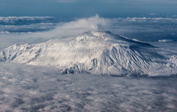 Mount Etna on Sicily. Island, Italy seen from plane window stock photography