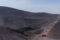 Mount Etna, Sicily. Italy: tourists walking on the edge of a crater of the volcano Stock Photos