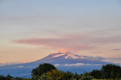 Mount Etna at sunset. The last rays of the day affecting the Etna volcano Stock Images