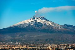 Mount Etna Volcano and Catania - Sicily Italy. The mount Etna Volcano with smoke and Silvestri craters in the Catania city, Sicily island, Italy Sicilia, Italia stock images