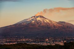 Catania and Mount Etna Volcano - Sicily Italy. The mount Etna Volcano with smoke and the Catania city, Sicily island, Italy Sicilia, Italia royalty free stock photo