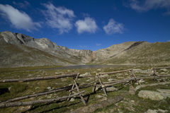 Mount Evans CO Summit Lake. A rocky mountain scenic with a fence and lake Stock Image