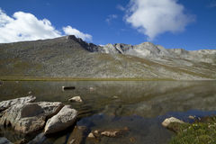 Mount Evans CO Summit Lake. A rocky mountain scenic with a reflective lake Stock Photos