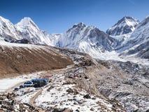 Mount Everest & Base Camp behind Path to Gorak Shep. Path to Gorak Shep on Everest Base Camp trek, with Mount Everest & Base Camp in the background stock image