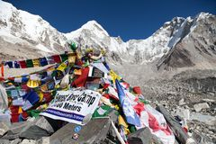 Mount Everest base camp with rows of buddhist prayer flags. EVEREST BASE CAMP, NEPAL, 14th NOVEMBER 2014 - view from Mount Everest base camp with rows of royalty free stock images
