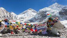 Mount Everest base camp with rows of buddhist prayer flags. EVEREST BASE CAMP, NEPAL, 14th NOVEMBER 2014 - view from Mount Everest base camp with rows of stock photos