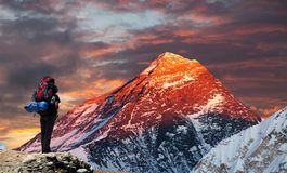 Mount Everest from Gokyo valley with tourist. Evening colored view of Mount Everest from Gokyo valley with tourist on the way to Everest base camp, Sagarmatha royalty free stock photography
