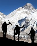 Mount Everest from Kala Patthar and silhouette of men Stock Photos