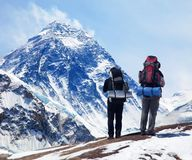 Mount Everest from Kala Patthar with two tourists. Panoramic view of Mount Everest from Kala Patthar with two tourists on the way to Everest base camp Royalty Free Stock Image