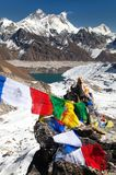 Mount Everest and Lhotse with buddhist prayer flags. View of Mount Everest and Lhotse with buddhist prayer flags from Gokyo Ri - way to Everest base camp Royalty Free Stock Photography
