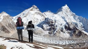 Mount Everest, Lhotse and Nuptse with two tourists Stock Photos