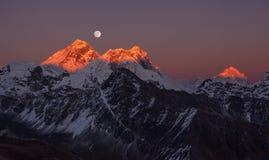 Mount Everest Makalu Peak. Panoramic view of the Mount Everest (8848 m) and Makalu peak (8485 m) at sunset on a full moon stock photo
