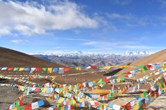 Mount Everest with prayer flags in foreground royalty free stock images