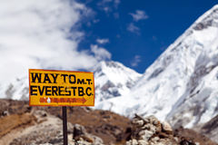 Mount Everest Signpost, Travel to Base Camp. Travel to Mount Everest Base Camp signpost in Himalayas, Nepal. Khumbu glacier and valley snow on mountain peaks stock image