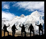 Mount Everest and silhouette of climbing men Royalty Free Stock Photos