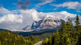 Mount Fitzwilliam in the Canadian Rockies. Mount Fitzwilliam as seen traveling east on the Yellowhead Highway, part of the Canadian Rockies. The lower half is stock photography