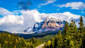 Mount Fitzwilliam, East on the Yellowhead Highway,  part of the Canadian Rockies. The lower half is dolomite. The upper half quartzite covered with lichen that royalty free stock photo