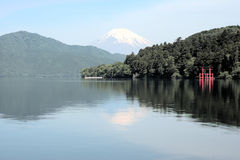 Mount fuji. And hakone shrine from lake ashi at moto-hakone with hdr effects stock image