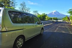 Mount Fuji as background and rental car Royalty Free Stock Photo