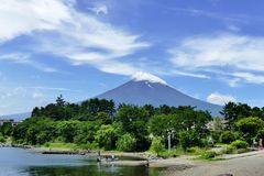Mount Fuji capped with a cloud seen from Kawaguchiko, Japan stock photography
