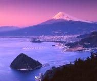 Mount Fuji CV. Mount Fuji at night with Suruga Bay in foreground Royalty Free Stock Image