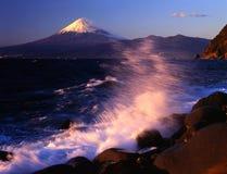 Mount Fuji CX. Waves breaking on the shore of Izu Penninsula with Mount Fuji Stock Photography