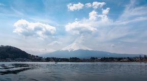 Mount Fuji Fujisan in midday from the boat at Kawaguchigo lake w Royalty Free Stock Image