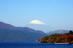Mount Fuji, Hakone National Park, Japan. The snow-capped peak of Mt. Fuji from Lake Ashi in Hakone National Park, Japan. The holy volcano of the Japanese culture Stock Photos