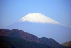 Mount Fuji, Hakone National Park, Japan. The snow-capped peak of Mt. Fuji from Lake Ashi in Hakone National Park, Japan. The holy volcano of the Japanese culture Royalty Free Stock Image
