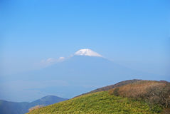 Mount Fuji, Hakone National Park, Japan. The snow-capped peak of Mt. Fuji from Mt. Komagatake in Hakone National Park, Japan. The holy volcano of the Japanese Stock Photo