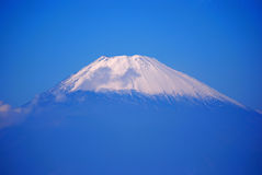 Mount Fuji, Hakone National Park, Japan. The snow-capped peak of Mt. Fuji from Mt. Komagatake in Hakone National Park, Japan. The holy volcano of the Japanese Royalty Free Stock Images