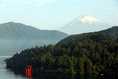 Mount Fuji Hakone. View over lake Ashino-ko and the red torii of Hakone shrine towards Mount Fuji from Moto-Hakone. beautiful sky with light clouds royalty free stock images