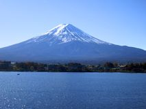 Mount Fuji -- Iconic Image of Mt. Fuji Over Lake. An iconic image of Mt. Fuji, Japan's most famous mountain, over a lake Royalty Free Stock Photos